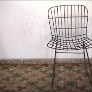 78 versions of Harry Bertoia's chair Model No. 420C, found in Aguacate, Cuba. Oct/2006.flv